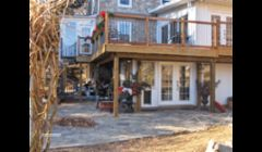 Custom sunroom six double french doors and cedar deck  with spiral staircase which overlooked beautiful lake.