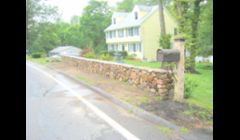 Stone wall w/ granite post