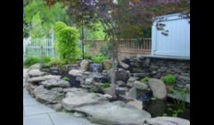 Waterfall Pond repair replace with Under water Lighting by Acorn Landscaping of Rochester NY in Pittsford NY