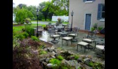 Bluestone/Slate Patio Replace/ Repair with Pondless Waterfall, Landscape Lighting and Plantings in Brighton NY by Acorn Landscaping of Rochester NY
