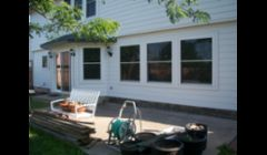 We change the window on the far left from a door.\ntook out 2 windows and made a patio door. Cement fiber siding and new windows throughout.  Amazing results.