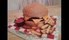 Double Cheeseburger Cake... fries are toasted pound cake & ketchup is red buttercream. =) Love this cake... looks SO real!! 