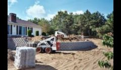Bobcat Construction Services: bobcat raking, grading, clearing, brush mowing, loam spread, lawn installations.