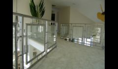 Contemporary stainless steel and safety glass railings.