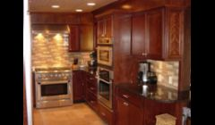 Cherry cabinetry, Tan Brown granite and commercial grade appliances make this kitchen's  owner very proud.
