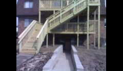 New deck and retaining wall added to 6 plex