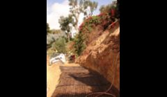 Landslide repair in Mission Hills on Bandini St. using Geo Grid soil reinforcement fabric.