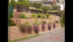 Landslide repair by installing terraced masonry and Keystone walls in Mission HIlls.