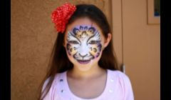Beautiful leopard face painting by Cynnamon\ www.facepaintingbycynnamon.com