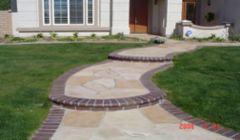 Flagstone walkway with brick boarders