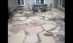 Flagstone patio before cleaning.