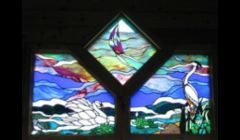 Water scene stained glass window for private residence