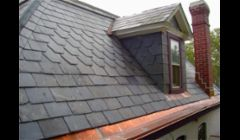 slate roof with inline copper gutters