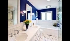 bathroom in blue: twin vanity sinks, ceramic tile floor, glass shower, jacuzzi tub