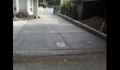 exposed driveway with concrete wall