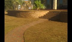 Landscape Concrete Retaining Wall with Paver Walkway
