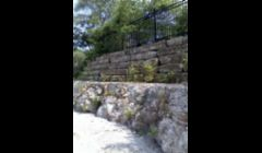 Natural Stone Retaining Wall with Decorative Iron Fence