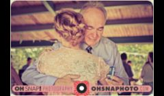 Roxie's father hugs her immediately following her wedding in Centennial Park in Lawrence, KS. By Ailecia Ruscin, 2012.