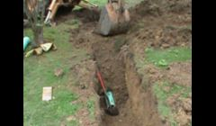 Trenching for a storm water system for downspouts and driveway drains.