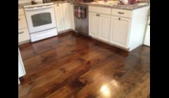 Wide plank New england white pine.  Sanded and stained English Chestnut(minwax)