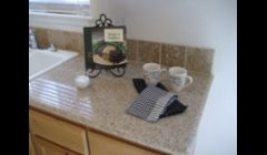 Small affordable kitchen with granite.