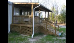 This is a front deck that we did with a tin roof.\n
