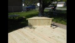 A 22' x 14' deck with two benches that open for storage.