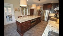 Cherry kitchen with Alaskan White granite countertops.
