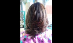 a soft brown hi lite on relaxed hair