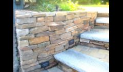 Stone wall w/ granite steps