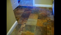 Ceramic tile floor w/inlays & many turns & cuts.