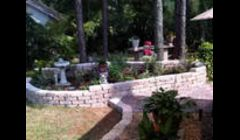 Raised planter and patio installed by Tampa Landscapes.