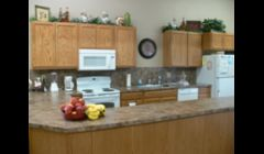 Our Kitchen and Dining Area. We have a large food preparation and serving area. We also use this area for crafts and other fun activities.