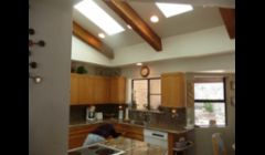 Custom sized skylights installed, original dropped ceiling was removed and whole ceiling was rebuilt and added six feet to the height.  All work done by The Skylight Specialist