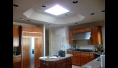 Skylight and opening designed to make kitchen space larger