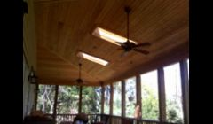 Rear porch with bead board ceiling.
